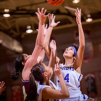 120513       Cable Hoover<br /> <br /> Miyamura Patriot Savannah Herrera (34) reaches up to grab a rebound away from the Winslow Bulldogs during the first round of the John Lomasney Girls Basketball Tournament Thursday at Gallup High School.