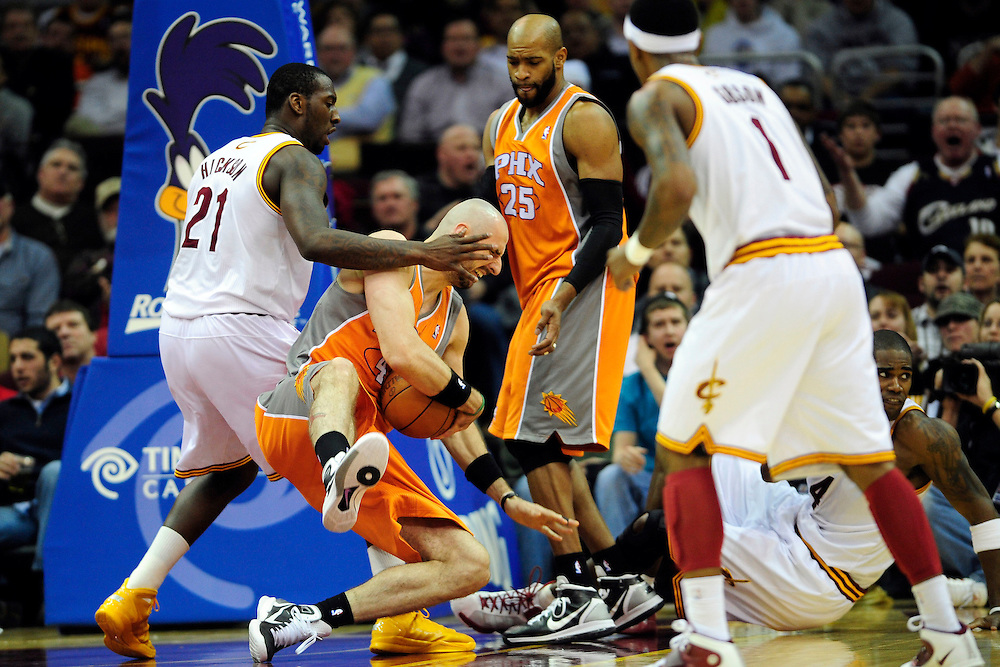 Jan. 19, 2011; Cleveland, OH, USA; Phoenix Suns center Marcin Gortat (4) falls to the ground after fighting for a rebound with Cleveland Cavaliers power forward J.J. Hickson (21) during the fourth quarter at Quicken Loans Arena. The Suns beat the Cavaliers 106-98. Mandatory Credit: Jason Miller-US PRESSWIRE