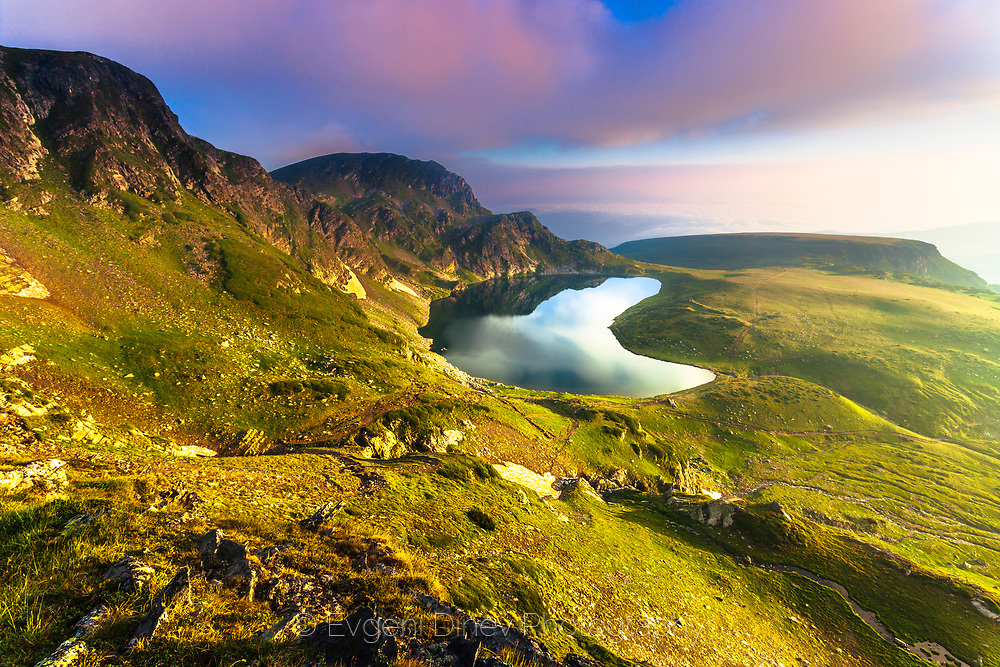 Mountain landscape with a beautiful lake at sunrise