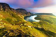Mountain lake in a shape of kidney