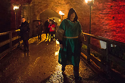 © licensed to London News Pictures. Shrewsbury, UK 24/11/2012. People leaving Ludlow Castle after Ludlow Medieval Christmas Fair with medieval lookalike clothes and items. This year's fair features with reactant shows and history tellers in the 11th century castle in Shrewsbury, Ludlow. Photo credit: Tolga Akmen/LNP