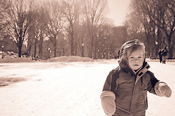 little boy with big mittens outdoors in Central Park during the Winter