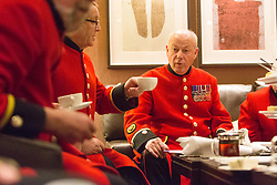 LNP HIGHLIGHTS OF THE WEEK 04/04/14 © Licensed to London News Pictures. 31/03/2014. London, UK. Chelsea Pensioners attend a 'Rosa Lewis' afternoon tea at The Cavendish hotel in Mayfair, London. The afternoon tea will be served during April and the hotel will make a donation to the Chelsea Hospital for every tea ordered in support of the 100th anniversary celebrations of the Great War. Photo credit : Vickie Flores/LNP
