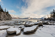 Stranded icebergs at low tide along Turnagain Arm near Hope in Southcentral Alaska. Winter. Afternoon.