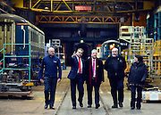 © Licensed to London News Pictures. 25/02/2013. Eastleigh, UK Eastleigh Borough Council Leader, Keith House (Red tie), Liberal Democrat Parliamentary Candidate for Eastleigh, Mike Thornton (Pink tie) Barry Stephenson Managing Director of Eastleigh Railway Works and Catherine Bearder, (grey coat) Liberal Democrat Member of the European Parliament for the South East of England, visit Arlington Fleet Services, based at the historic Eastleigh Railway Works site. Campaigning in the weeks ahead of The Liberal Democrats winning the Eastleigh by-election, with the UK Independence Party pushing the Conservatives into third place.. Photo credit : Stephen Simpson/LNP