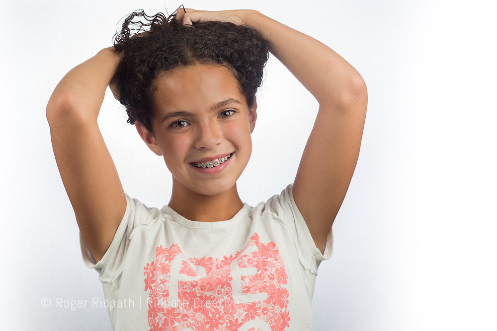 young girl with braces and hair up portrait