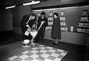 23/03/1966<br /> 03/23/1966<br /> 23 March 1966<br /> Exhibition of Columbus-Dixon Floor Maintenance Equipment and a range of Johnson Wax products run by Goodbody Ltd. at the Building Centre, Dublin. Pictured at the event are Mr Gerry O'Donoghue, Service Products Representative, Goodbody Ltd., demonstrating the products to Mr Thomas Swan, Cleaning Supervisor, C.I.E. and Mrs Lucy Kane, Charge Hand, Cleaning Section, C.I.E., O'Connell Street, Branch, Dublin.