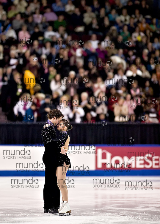 Ottawa, Ontario ---06/1/14--- Jessica Dube and Bryce Davison embrace after finishing their free program in the senior pair competition at the Canadian Championships in Ottawa Saturday January 14, 2006. The couple placed second..GEOFF ROBINS The Ottawa Sun<br />