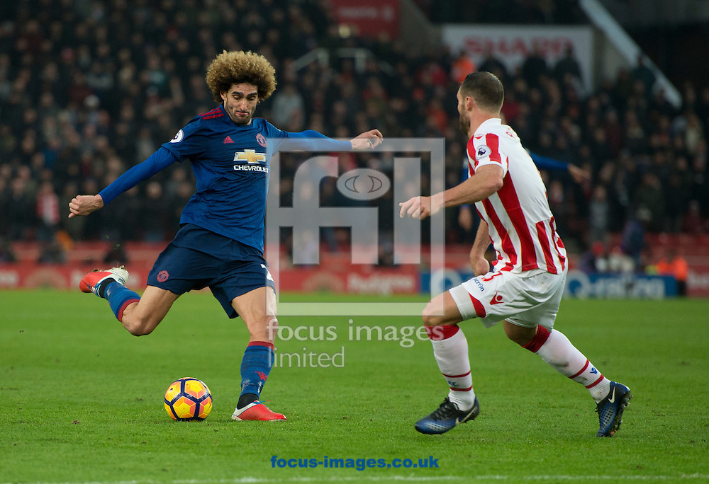 Marouane Fellaini of Manchester United shoots at goal during the Premier League match at the Bet 365 Stadium, Stoke-on-Trent<br /> Picture by Russell Hart/Focus Images Ltd 07791 688 420<br /> 21/01/2017