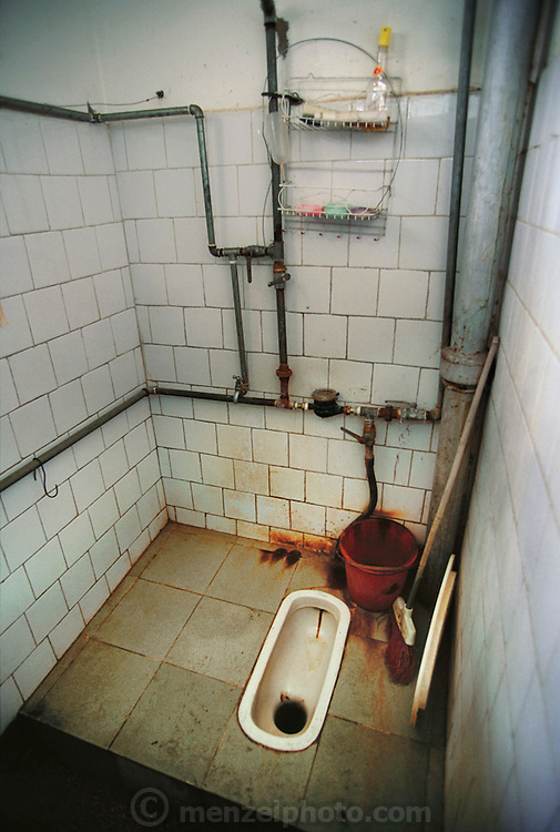 Squat toilet in a private home in Menghan, Xishuangbanna, China.