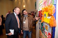 Egyptian Hussain Abouhashish from Tralee with Minister Ciaran Cannon at the exhibition and performance day at the Radisson Blu Hotel Galway as part of the VEC's Adult Refugee Programme. Photo:Andrew Downes.