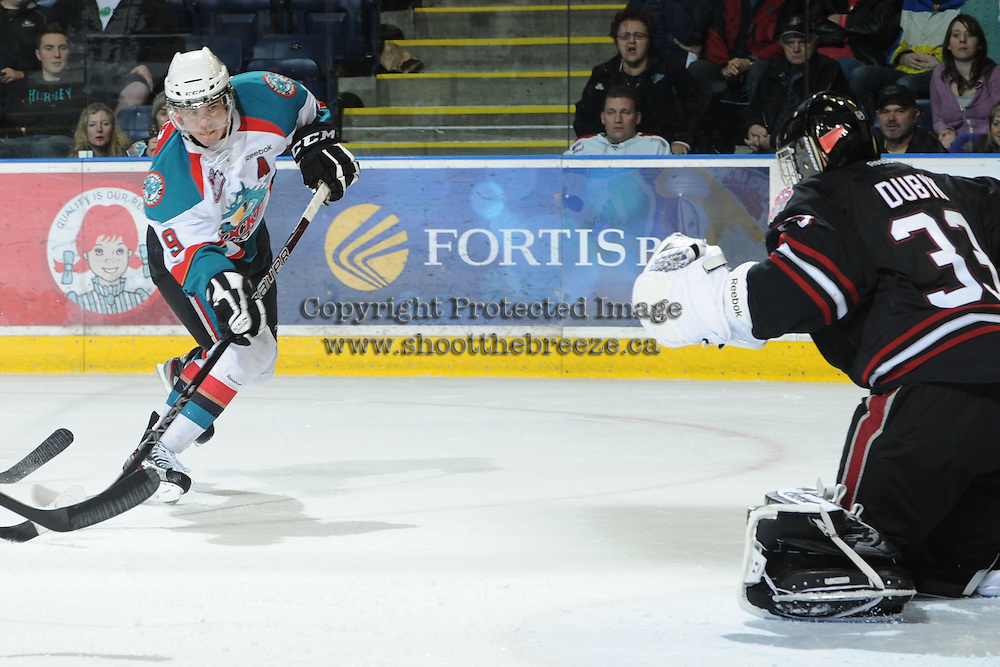 KELOWNA, CANADA - FEBRUARY 18: Brett Bulmer #19 of the Kelowna Rockets takes a shot against the Red Deer Rebels at the Kelowna Rockets on February 18, 2012 at Prospera Place in Kelowna, British Columbia, Canada (Photo by Marissa Baecker/Shoot the Breeze) *** Local Caption ***