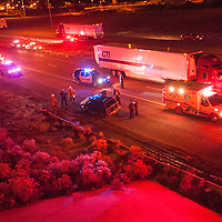 110113       Cable Hoover<br /> <br /> Police and emergency personnel partially reopen the interstate as they clear the scene of a crash on east bound Interstate 40 Friday.