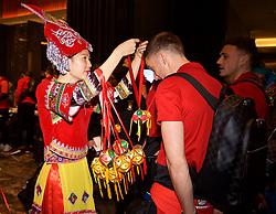 NANNING, CHINA - Monday, March 19, 2018: Wales' Andy King is greeted by a woman in traditional costume as the team arrive at the Wanda Realm Resort in Nanning for the 2018 Gree China Cup International Football Championship. (Pic by David Rawcliffe/Propaganda)