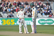Chris Read and Stuart Broad discuss the bounce of the ball during a mid wicket conference during the Specsavers County Champ Div 1 match between Lancashire County Cricket Club and Nottinghamshire County Cricket Club at the Emirates, Old Trafford, Manchester, United Kingdom on 17 April 2016. Photo by Simon Trafford.