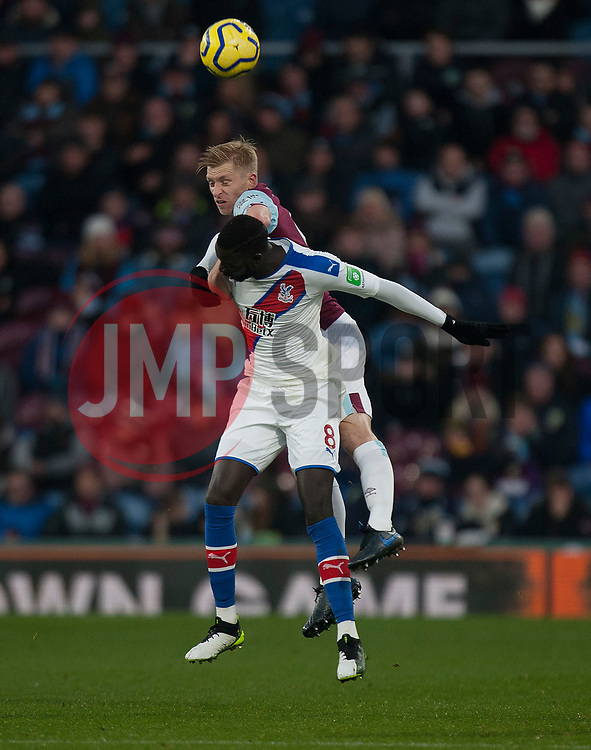 Ben Mee of Burnley (Top) and Cheikhou Kouyate of Crystal Palace in action - Mandatory by-line: Jack Phillips/JMP - 30/11/2019 - FOOTBALL - Turf Moor - Burnley, England - Burnley v Crystal Palace - English Premier League