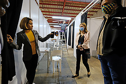 JOHANNESBURG, SOUTH AFRICA - APRIL 25: Officials discuss the private consultation rooms on a walkabout at the Nasrec quarantine site currently under construction. With isolation units, consultation areas, ICU capabilitiies, medical facilities, power points, drainage and ablutions the quarantine site has a total bed capacity of 2300 on April 25, 2020 in Johannesburg South Africa. Under pressure from a global pandemic. President Ramaphosa declared a 21 day national lockdown extended by another two weeks, mobilising goverment structures accross the nation to combat the rapidly spreading COVID-19 virus - the lockdown requires businesses to close and the public to stay at home during this period, unless part of approved essential services. (Photo by Dino Lloyd)