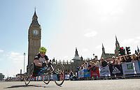 Wheelchair racer at Big Ben<br /> <br /> The Virgin Money London Marathon 2014<br /> 13 April 2014<br /> Photo: Tom Lovelock/Virgin Money London Marathon<br /> media@london-marathon.co.uk