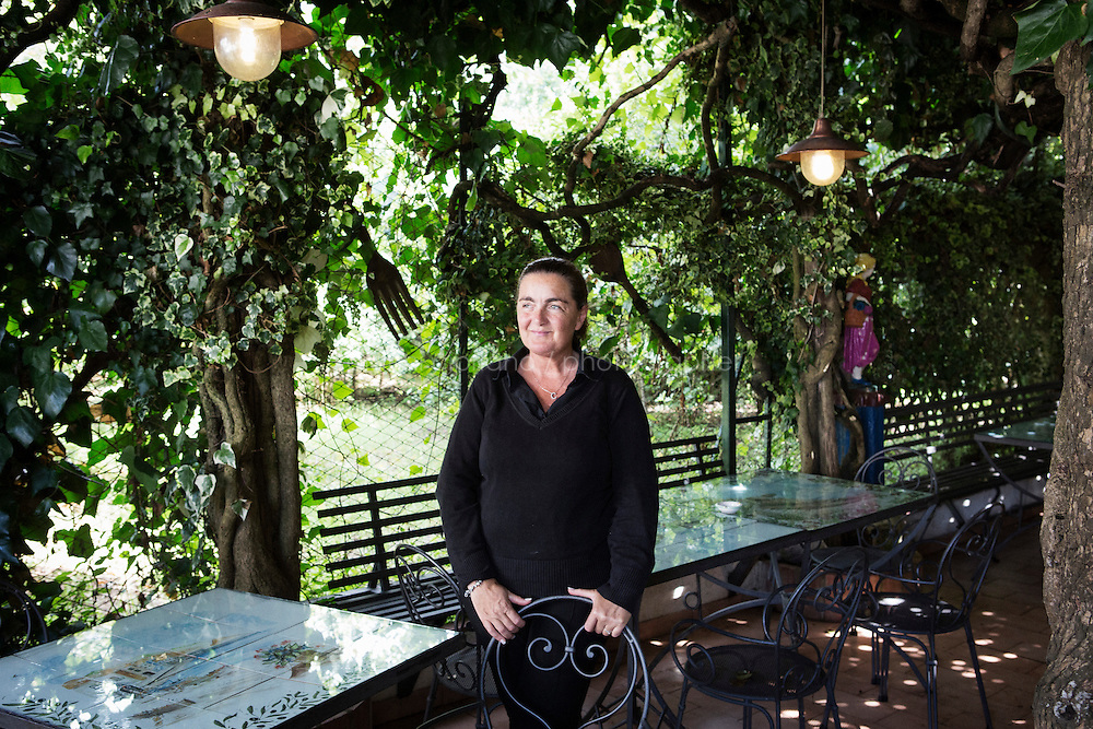 ANACAPRI, ITALY - 22 JULY 2014: Carmen Cappa, owner of the restaurant &quot;Trattoria il Solitario&quot;, poses for a portrait at her restaurant in Anacapri, a small comune on the island of Capri, Italy, on July 22nd 2014. Mayor of New York Bill De Blasio and his family had dinner at the restaurant &quot;Trattoria il Solitario&quot;  the evening of their arrival.<br /> <br /> New York City Mayor Bill de Blasio arrived in Italy with his family Sunday morning for an 8-day summer vacation that includes meetings with government officials and sightseeing in his ancestral homeland.