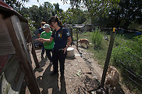 Ashley Mauceri, of the HSUS Animal Rescue Team, show pens to veterinarian Judi C Vogt during a raid on a puppy mill in Johnston, SC on Tuesday, Sept. 11, 2012. HSUS workers found over 200 dogs, nine horses and 30-40 fowl. (Vogt: 704-699-8896)