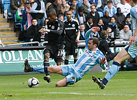 Photo: Steve Bond/Richard Lane Photography.<br />Coventry City v Chelsea. FA Cup 6th Round. 07/03/2009. Salomon Kalou (L) is tackled by Michael Doyle (R)