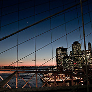 People on the Brooklyn Bridge by night.