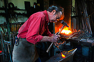 Metal craftsman Nol Putnam at work in his studio in Rappahannock  County Virginia