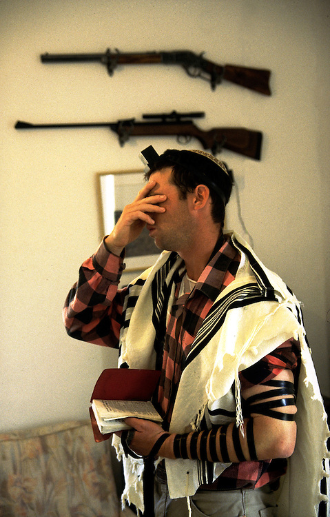 Ofer Hiltovski 30 is praying his morning pray before he go to work as a cowboy watch the flock of Moshav Yehonatan in the Golan height, Israel. Tuesday October 14, 1999......