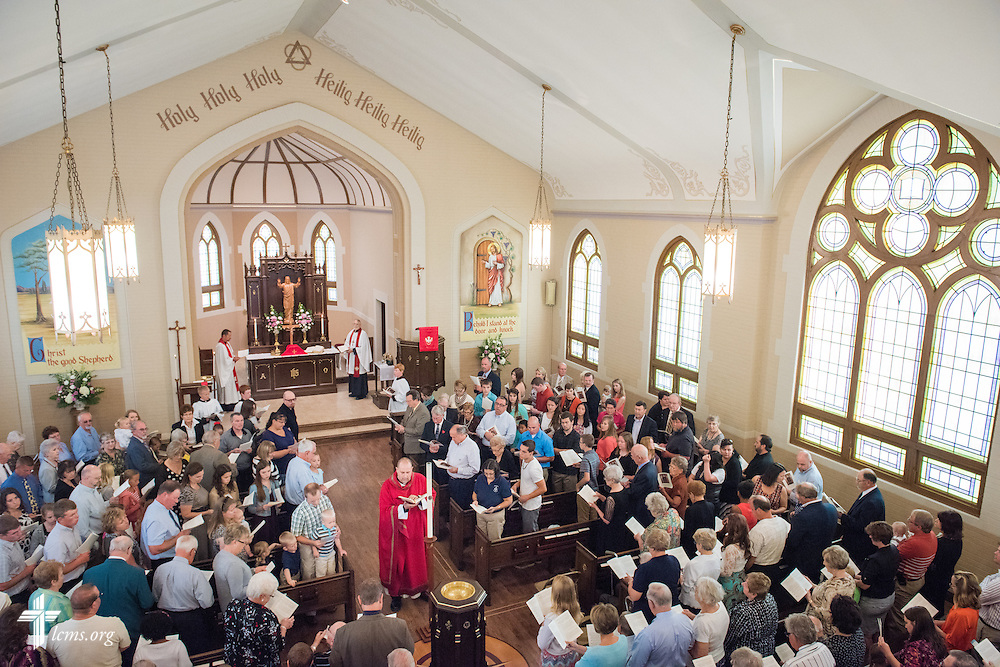The Rev. Benjamin Ball blesses the baptismal font during a Divine Service of Rededication at St. Paul Lutheran Church in Hamel, Ill., on Sunday, Sept. 7, 2014. LCMS Communications/Erik M. Lunsford