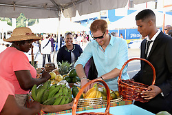 Prince Harry visits a market during a St Lucian street festival in Soufriere on the island of St Lucia during the second leg of his Caribbean tour.