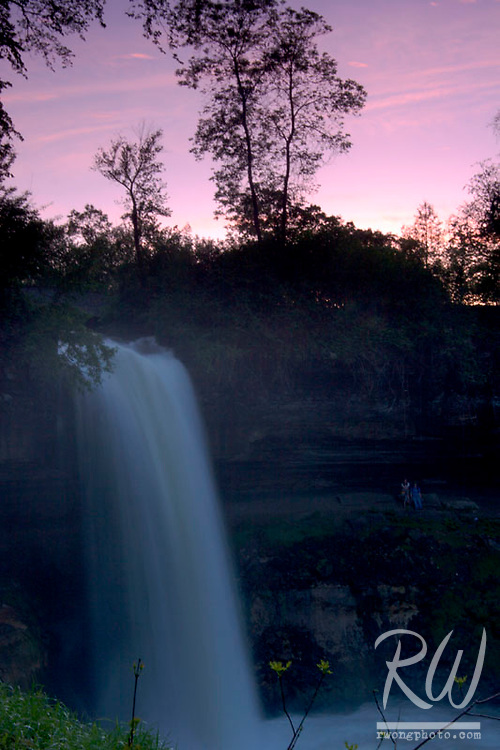 People Relaxing Near Minnehaha Falls at Dusk, Minneapolis, Minnesota