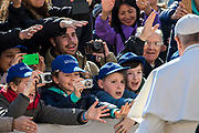 Pope Francis greets student as he arrives in St. Peter's Square for his weekly general audience, at the Vatican, Wednesday, March 14, 2018.