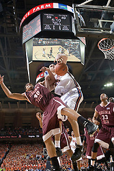 Virginia Cavaliers forward Jason Cain (33) grabs a rebound from Virginia Tech Hokies forward A.D. Vasallo (40).  The Virginia Cavaliers Men's Basketball Team defeated the Virginia Tech Hokies 69-56 at the John Paul Jones Arena in Charlottesville, VA on March 1, 2007.