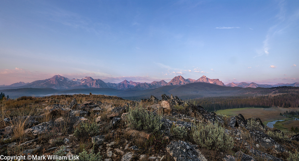 The Sawtooth Peaks rise dramatically above the valley floor in the Stanley Basin.