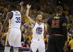 June 12, 2017 - Oakland, CA, USA - The Golden State Warriors' Stephen Curry (30) and Kevin Durant (35) high-five against the Cleveland Cavaliers in the second quarter of Game 5 of the NBA Finals at Oracle Arena in Oakland, Calif., on Monday, June 12, 2017. (Credit Image: © Nhat V. Meyer/TNS via ZUMA Wire)