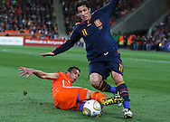 JOHANNESBURG, SOUTH AFRICA- Sunday 11 July 2010, Joan Capdevila gets tackled by Robin van Persie during the final between Spain The Netherlands (Holland) held at Soccer City in Soweto during the 2010 FIFA Soccer World Cup..Photo by Roger Sedres/Image SA