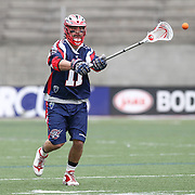 Matt Smalley #11 of the Boston Cannons passes the ball during the game at Harvard Stadium on April 27, 2014 in Boston, Massachusetts. (Photo by Elan Kawesch)