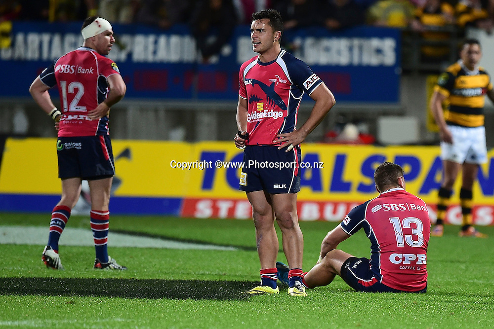 Tasman Makos Tom Marshall (L), Tasman Makos James Lowe and Kieron Fonotia (R stand dejected after their loss during the ITM Cup Premiership Final between Taranaki & Tasman at Yarrow Stadium in New Plymouth, New Zealand, 25th October 2014. Photo: Marty Melville/Photosport.co.nz