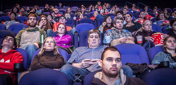 12.27.2012  A crowd watches previews at the Century 16 movie theater, Anchorage