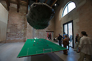"Punta della Dogana. The former customs house has been rented for 33 years by french billionaire and art collector Francois Pinault, who had it adapted and renovated by Japanese star architect Tadao Ando. Huang Yong Ping, ""A Football Match of June 14th, 2002"", 2002."