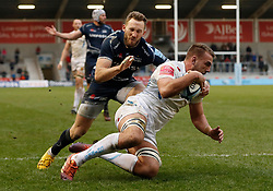 Sale Sharks Byron McGuigan (left) fails to prevent Exeter Chiefs' Sean Lonsdale from scoring his teams third try during the Gallagher Premiership match at the AJ Bell Stadium, Salford.
