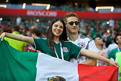 MOSCOW, RUSSIA - Sunday, June 17, 2018: A Mexico supporter celebrates as her Germany supporting partner looks dejected after beating Germany 1-0 during the FIFA World Cup Russia 2018 Group F match between Germany and Mexico at the Luzhniki Stadium. (Pic by David Rawcliffe/Propaganda)