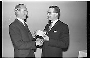 Tom Hennessy Presentation..1963..03.10.1963..10.03.1963..3rd October 1963. .At the South County Hotel, Stillorgan, Dublin, a presentation of a cheque was made to Mr Tom Hennessy by Mr O'Carroll, Manager, Andrews Ltd...Image shows Mr Hennessy receiving the cheque from Mr O'Carroll of Andrews ltd.
