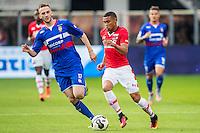 ALKMAAR - 10-09-2016, AZ - Willem II, AFAS Stadion, 2-0,  Willem II speler Branco van den Boomen, AZ speler Dabney dos Santos Souza (r)