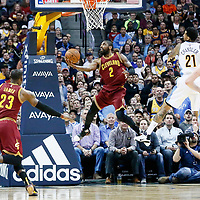 22 March 2017: Cleveland Cavaliers guard Kyrie Irving (2) goes for the reverse layup past Denver Nuggets forward Wilson Chandler (21) during the Denver Nuggets 126-113 victory over the Cleveland Cavaliers, at the Pepsi Center, Denver, Colorado, USA.