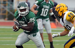 18 October 2014:  Anfernee Roberts pursued by Erik Johnson during an NCAA division 3 football game between the Augustana Vikings and the Illinois Wesleyan Titans in Tucci Stadium on Wilder Field, Bloomington IL