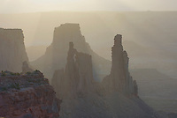 Washer Woman and Monster Tower silhouetted at sunrise, Canyonlands National Park Utah