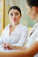 Two business women sitting in meeting