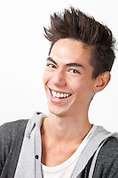 Portrait of happy young mixed race man against white background