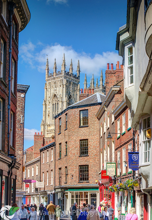 Low Petergate, York, with a view to the Minster.  It is busy with shoppers on an April afternoon.